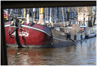 Boat and canal in Amsterdam